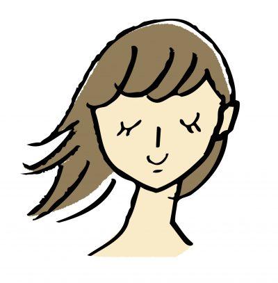 右側の髪の毛が跳ねている女性