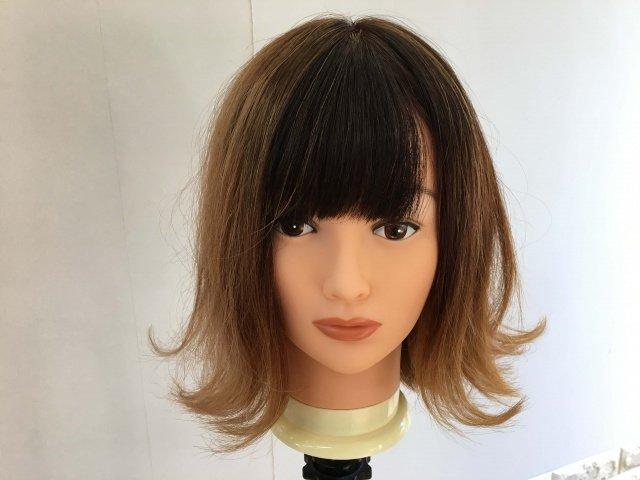外ハネになっている髪型スタイリング後の写真