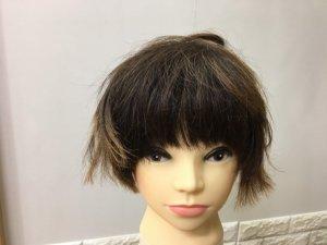 蒸しタオルを外したショートヘアの写真