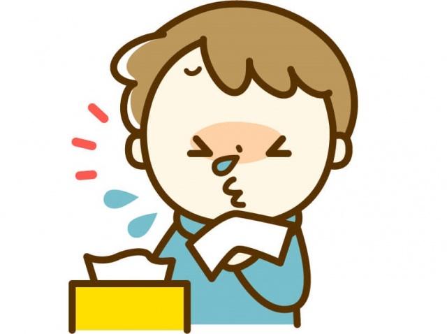 くしゃみをする男の子のイラストの写真