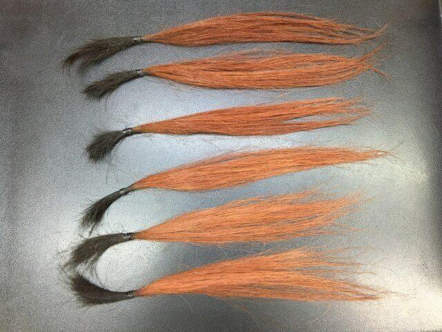 ピンクベージュを染め直した髪の毛の写真